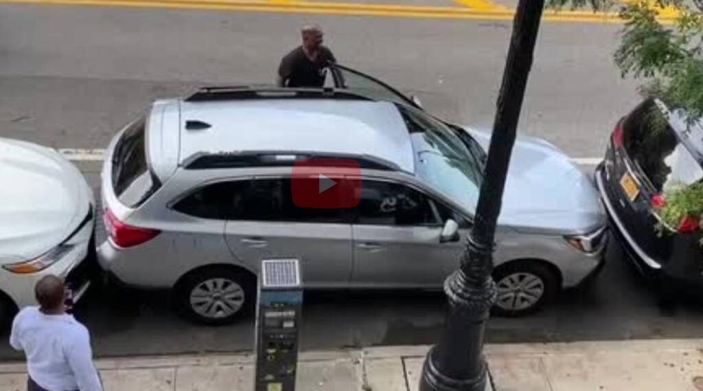 Man pulls out car from tight parking spot Watch Viral Video